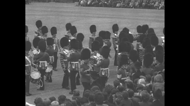 vs coldstream guards band marches across field / princess marina duchess of kent princess margaret queen mother mary queen elizabeth and king george... - princess margaret 1950 stock videos and b-roll footage