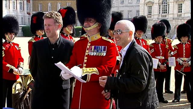 Coldstream Guards bandleader signing record deal with Decca Record executives Lieutenant Colonel Graham Jones interview SOT Daniel Glatman photocall...