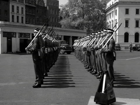 Coldstream Guards rehearse presenting arms to the rhythm of a metronome at the Wellington barracks 1959