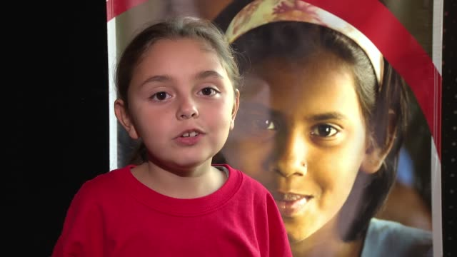 vídeos de stock, filmes e b-roll de colette prainito, save the children sponsor, age 8, talks about the girl she sponsors and why she does it, on how she came to sponsor, shares her... - new age