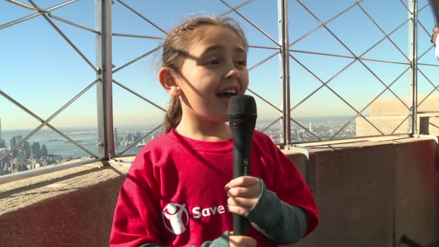 vídeos de stock, filmes e b-roll de colette prainito, sponsor, age 8 on why it was cool to light the empire state building building red at dakota fanning lights the empire state... - new age