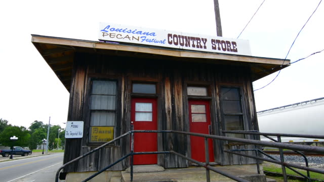 colfax louisana small town famous for louisana pecan festival railroad festival country store - western script stock videos & royalty-free footage