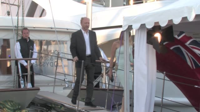 Colin Firth accompanied with wife as well as producer Harvey Weinstein and other actors attended a party on a boat for the film 'Before i go to...