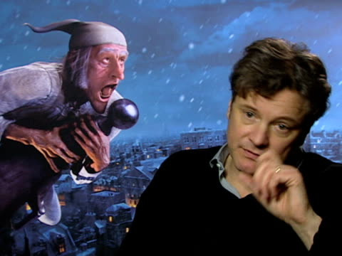 vídeos de stock, filmes e b-roll de colin firth on how he gets a jolt watching himself on how he views himself as an 18 year old at the a christmas carol interviews at london england - colin firth