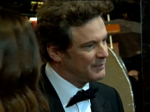 vídeos de stock, filmes e b-roll de colin firth on the red carpet at the british academy film awards 2011 - colin firth