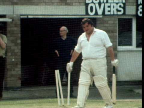 colin milburn has his first try out england northampton county ground seen through net lms bowler pan to milburn zoom in cs pull to ms milburn sof... - northampton england stock videos & royalty-free footage