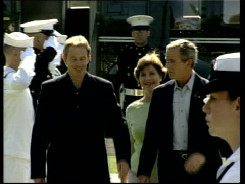 colin powell in switzerland/ human shields itn lib sept 2002 usa ext prime minister tony blair mp along from helicopter with us president george... - tony blair stock-videos und b-roll-filmmaterial
