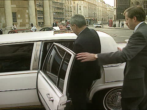 colin powell visits uk; england: london: bbc broadcasting house: colin powell out entrance towards powell climbing into limo tx 9.10.95/nao - itv news at one stock videos & royalty-free footage
