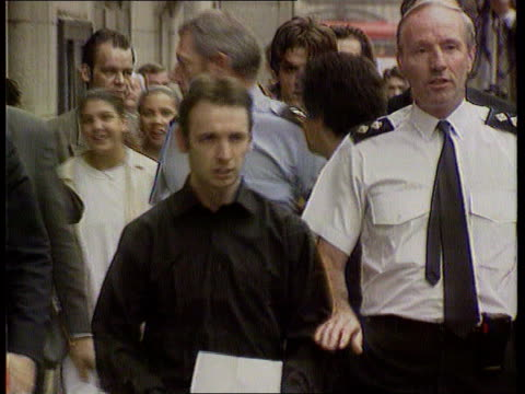 Colin Stagg arrested ITN London Old Bailey CMS Colin Stagg towards with policeman PULL OUT ditto
