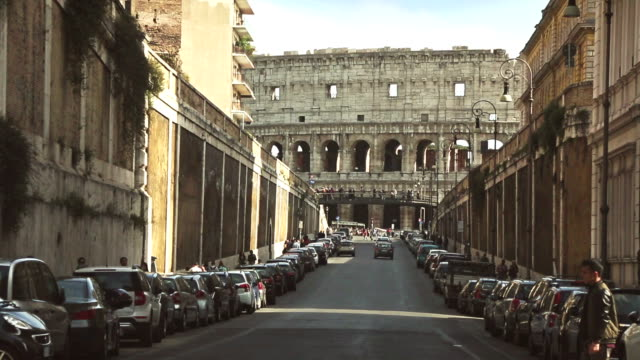 coliseum from via dei serpenti in rome - telephoto lens stock videos and b-roll footage
