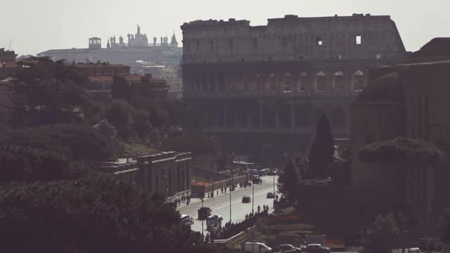 stockvideo's en b-roll-footage met coliseum of rome from vittorio emanuele monument - cross processen