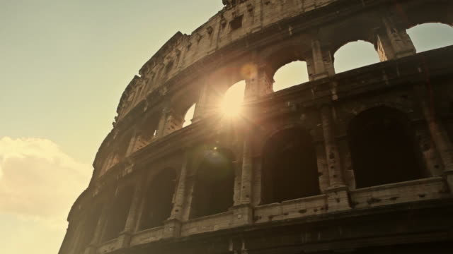 coliseum of rome, or colosseo, with sun flares - old ruin stock videos & royalty-free footage