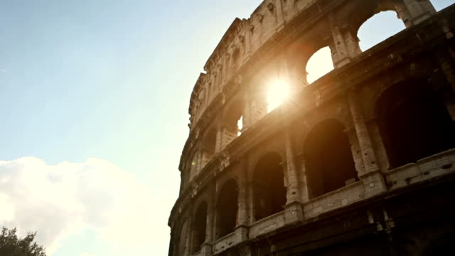 coliseum of rome, or colosseo, with sun flares - amphitheater stock videos & royalty-free footage
