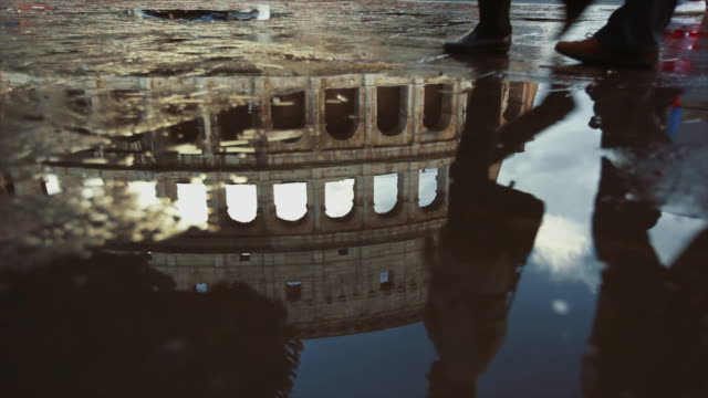 coliseum of rome reflected in water after a summer rain - history stock videos & royalty-free footage