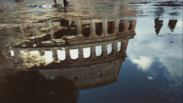 coliseum of rome reflected in water after a summer rain - amphitheater stock videos & royalty-free footage