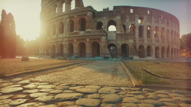 coliseum of rome with warm sun at early morning - history stock videos & royalty-free footage