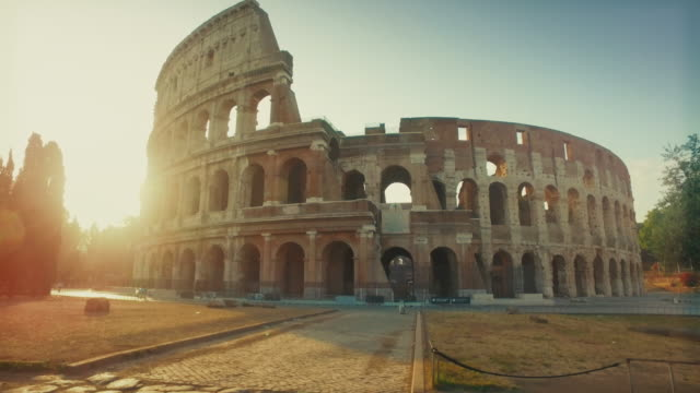 coliseum of rome with warm sun at early morning - rome italy stock videos & royalty-free footage