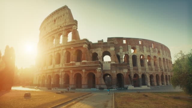Coliseum of Rome with warm sun at early morning