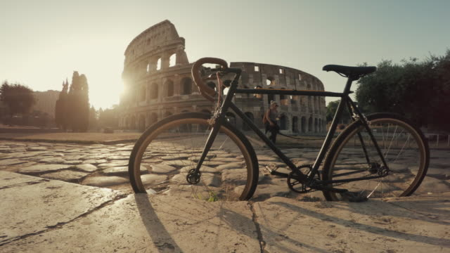 coliseum of rome with warm sun at early morning - colosseum rome stock videos and b-roll footage