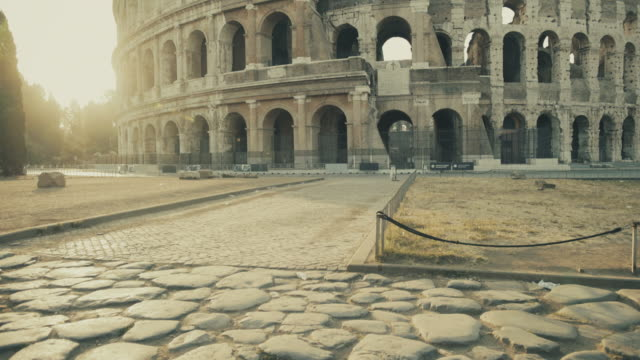 coliseum of rome with warm sun at morning - colosseo video stock e b–roll