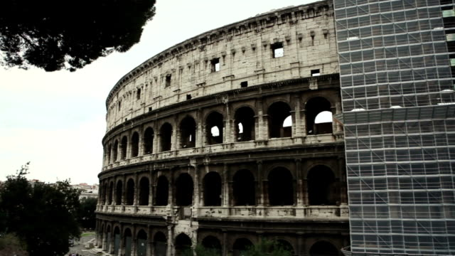 coliseum renovation, covered by scaffolding - monument stock videos & royalty-free footage