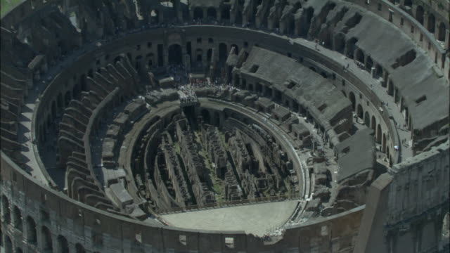low aerial, coliseum, rome, italy - colosseo video stock e b–roll