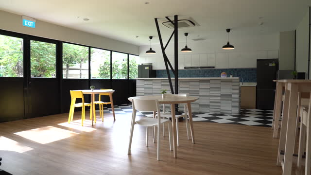 co-living residential building interior design, kitchen area in singapore city, singapore, on wednesday, september 8, 2021. there aren't any... - electric lamp stock videos & royalty-free footage