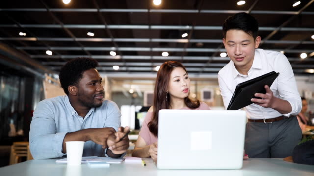 collaborating global on video conference - asian colleague stock videos & royalty-free footage