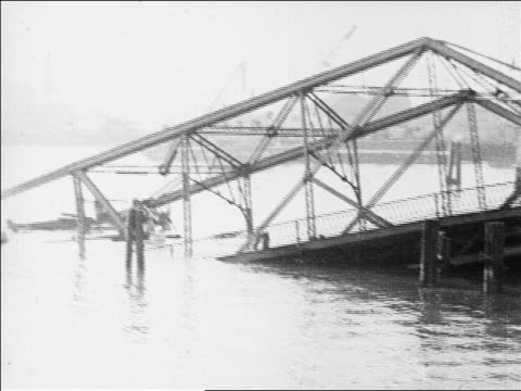 collapsed bridge in water / tugboat passes in foreground / san francisco / newsreel - 1926 stock videos & royalty-free footage