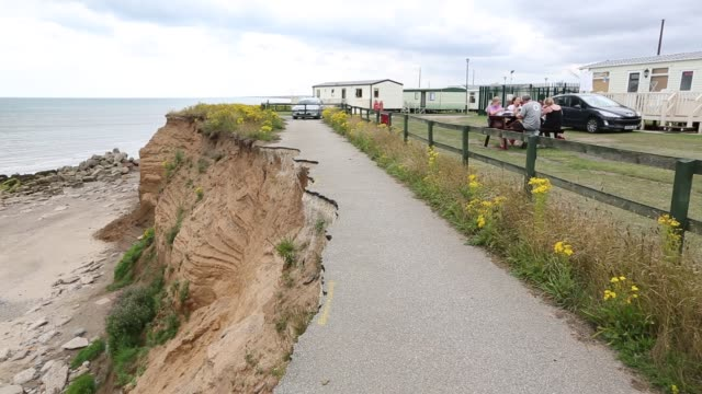 a collapsed coastal road at barmston on yorkshires east coast, near skipsea, uk. the coast is composed of soft boulder clays, very vulnerable to coastal erosion. this sectiion of coast has been eroding since roman times, with many villages having disappea - eroded stock videos & royalty-free footage