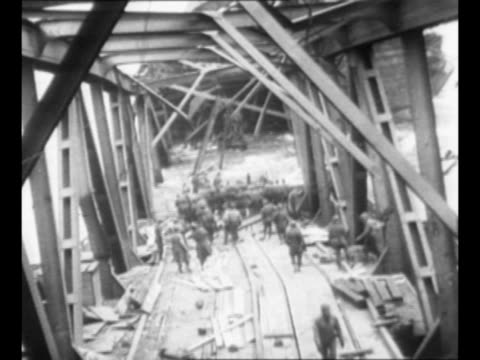 ws collapsed ludendorff bridge over the rhine river after allied capture during world war ii / ms metal span separated from pillar on shore with... - pontoon bridge stock videos and b-roll footage