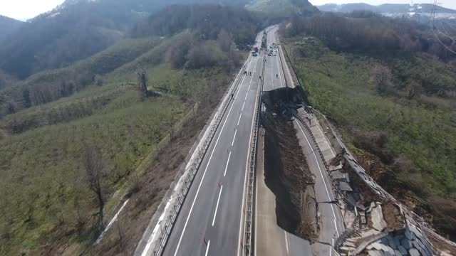 stockvideo's en b-roll-footage met collapsed road in turkey's duzce-zonguldak western black sea linking road recorded by drone on saturday . both directions of the road closed to... - natuurramp