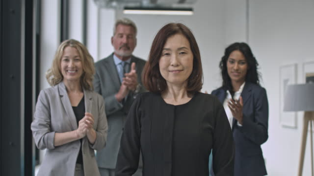 colleagues applauding japanese businesswoman - femininity stock videos and b-roll footage