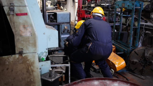 colleagues are going to help workers who are injured from industrial machinery. - engineer stock videos & royalty-free footage