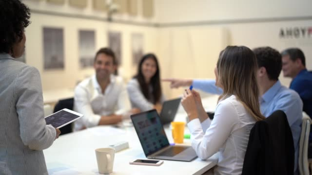 colleagues at business meeting in conference room - workshop stock videos & royalty-free footage