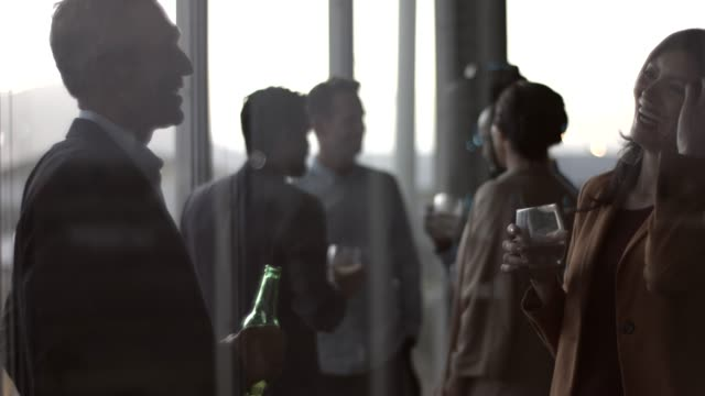 colleagues enjoying drinks during party in office - business person stock videos & royalty-free footage