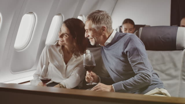 colleagues enjoying red wine in corporate jet - shaky stock videos & royalty-free footage