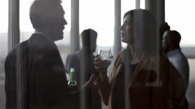colleagues having drinks during office party - after work stock videos & royalty-free footage