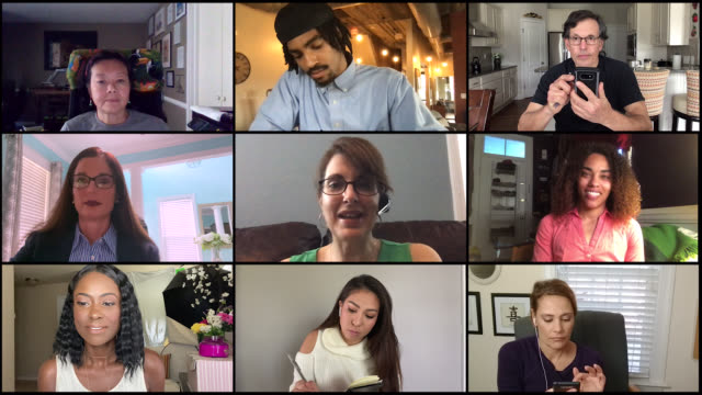 vídeos y material grabado en eventos de stock de colleagues hold video conference call during covid-19 (audio) - compañero de trabajo