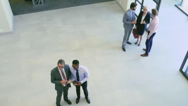 Colleagues in office corridor