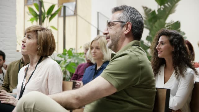 colleagues listening during networking event - business conference stock videos & royalty-free footage