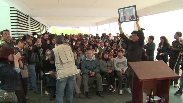 colleagues of prominent photojournalist ruben espinosa murdered in mexico city last july auction photos donated by various visual journalists to... - photojournalist stock videos & royalty-free footage
