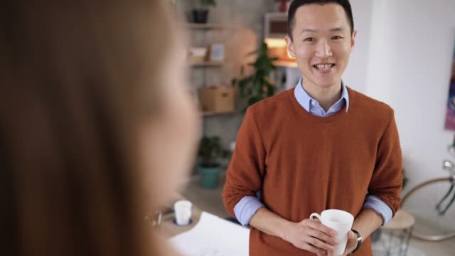 colleagues sharing new ideas on coffee break - coffee break stock videos & royalty-free footage