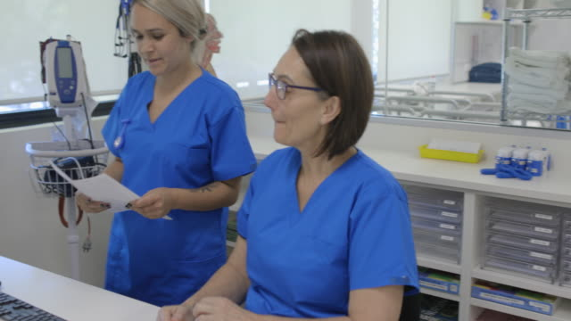 colleagues talking - nurse working stock videos & royalty-free footage