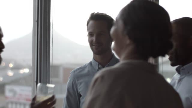colleagues toasting drinks during office party - einen toast ausbringen stock-videos und b-roll-filmmaterial