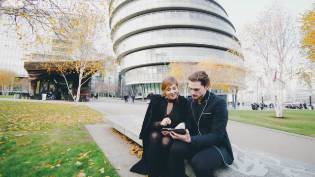 DS Colleagues using digital tablet in front of GLA Building