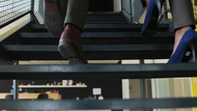 colleagues walking up stairs - lavoro e impiego video stock e b–roll