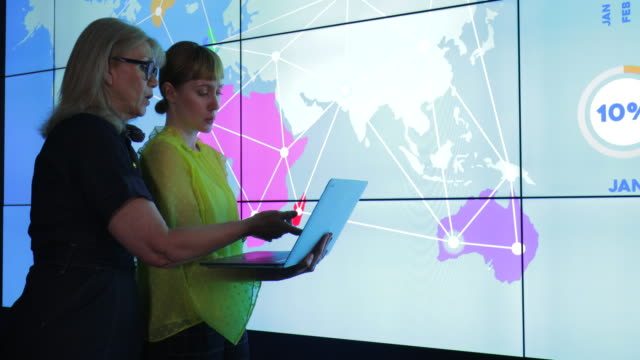 colleagues with interactive information wall - presentation stock videos & royalty-free footage