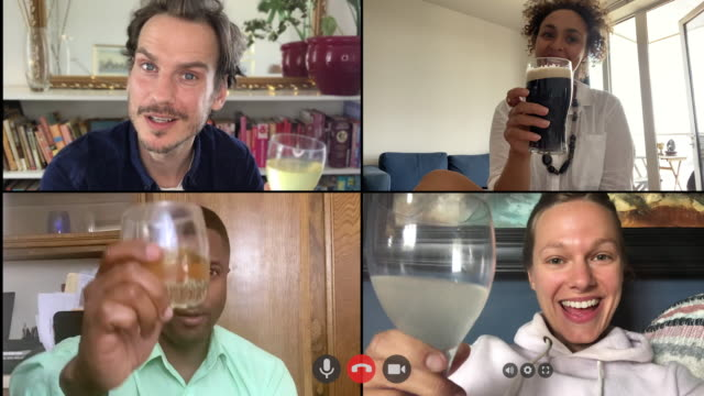 colleagues working from home on video conference call and enjoying virtual drinks on friday afternoon - happy hour video stock e b–roll