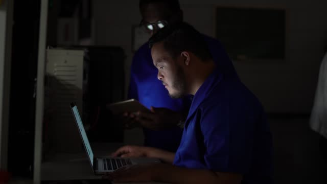colleagues working together and using laptop in industry - disability services stock videos & royalty-free footage